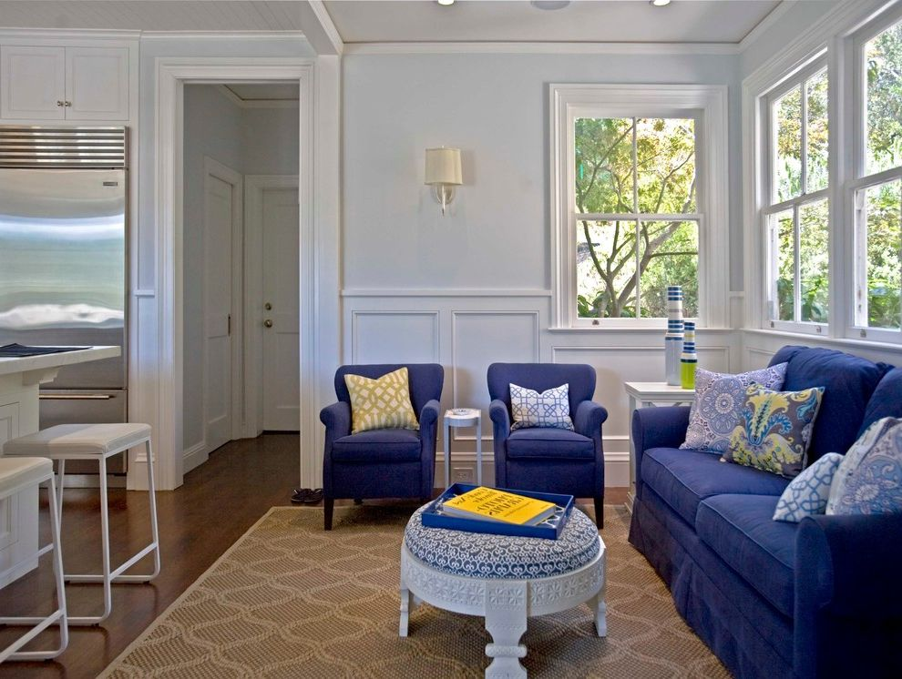 Ross Modesto Ca with Contemporary Family Room  and Bold Patterns Clean Counter Stools Family Room Frame and Panel Millwork Navy Open Ottoman Seating Stainless Steel Appliances Wainscot White White Casing Woven Area Rug Yellow