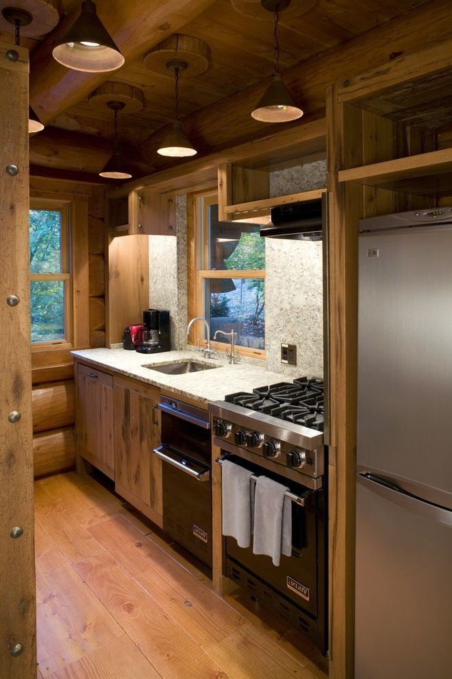 Samsung Stoves   Rustic Kitchen  and Black Appliances Granite Knotty Pine Log Beams Log Home Natural Wood Pendant Lights Pine Rustic Small Kitchen Stainless Steel Vaulted Ceiling Wood Floor