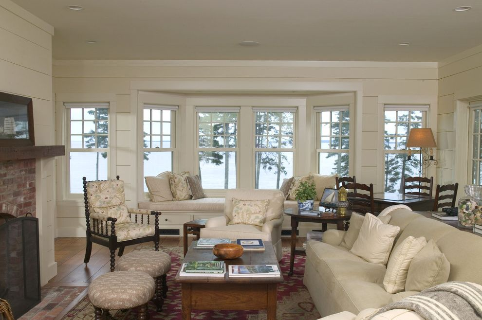Time Card Calculator with Lunch with Traditional Living Room  and Bay Window Brick Fireplace Fireplace Horizontal Wood Walls White Furniture White Walls White Wood Window Seat Wood Floors Wood Walls