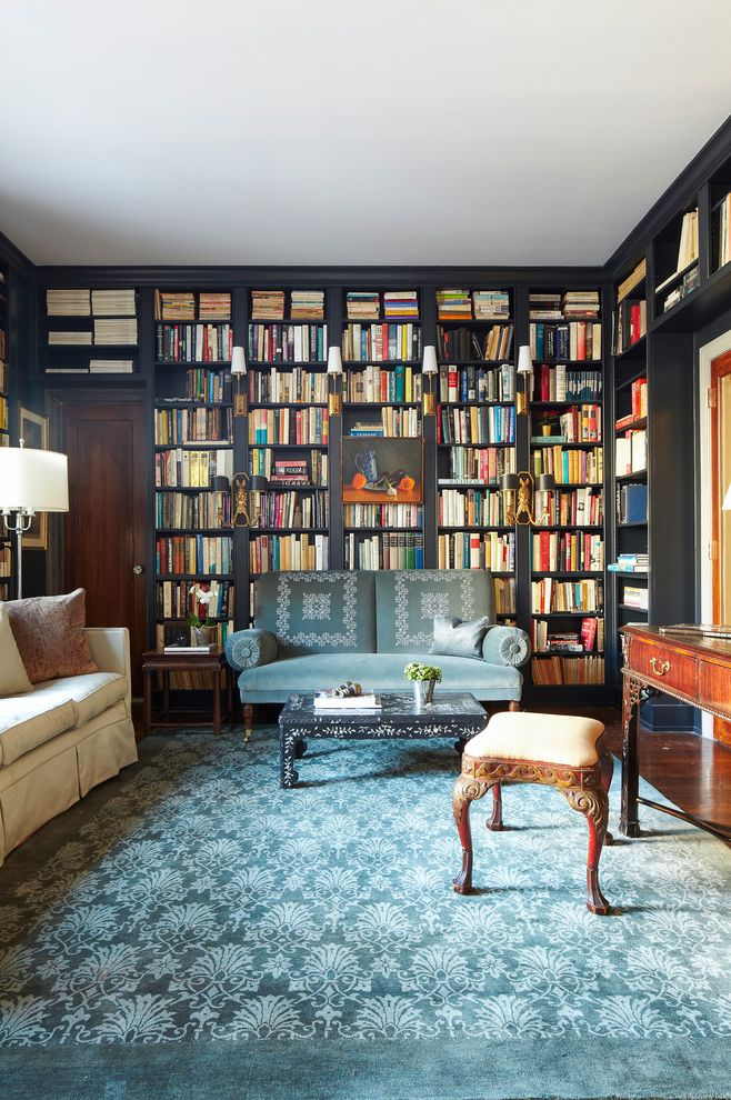 Unruh Furniture   Eclectic Family Room  and Antique Furniture Built in Bookcase Built in Bookshelves Crown Molding Dark Trim Dark Walls Library Sconce Wall Lighting Wood Flooring