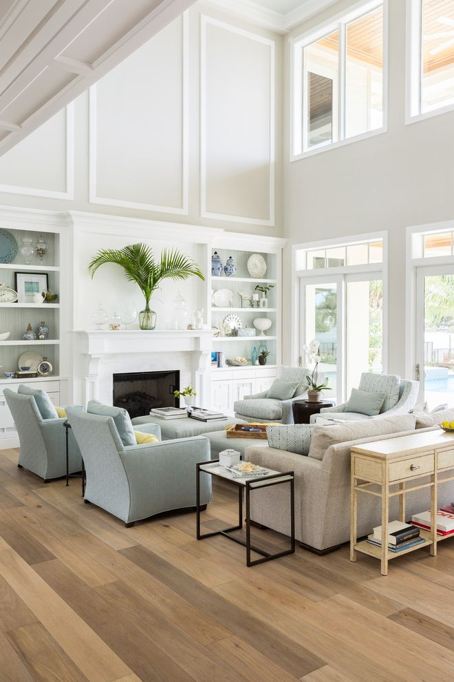 Unruh Furniture with Beach Style Living Room Also Accessories Apothecary Jars Blue Books Coastal Decor Coastal Home Coastal Style Coral Fireplace Glasse Vase Palm Leaf Shells Shelves Side Tables Sitting Area Sofa Upholstered Chairs White Wood Floor