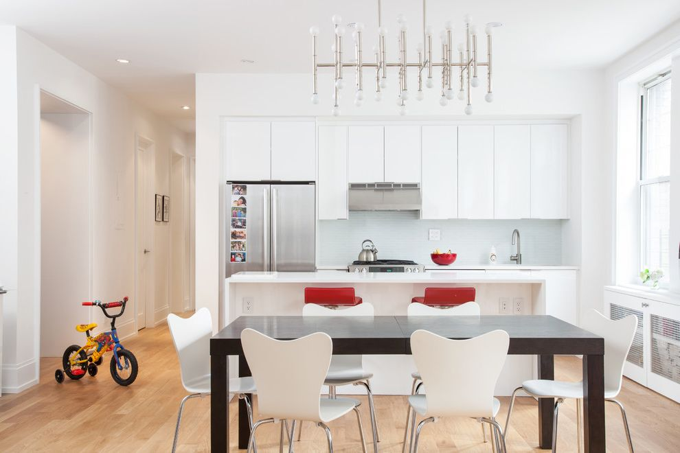 Unruh Furniture with Contemporary Dining Room Also Chandelier Dining Table Light Ikea Loft Open Layout Stainless Steel Appliances White Countertop White Dining Chairs White Kitchen Cabinets White Oak White Walls
