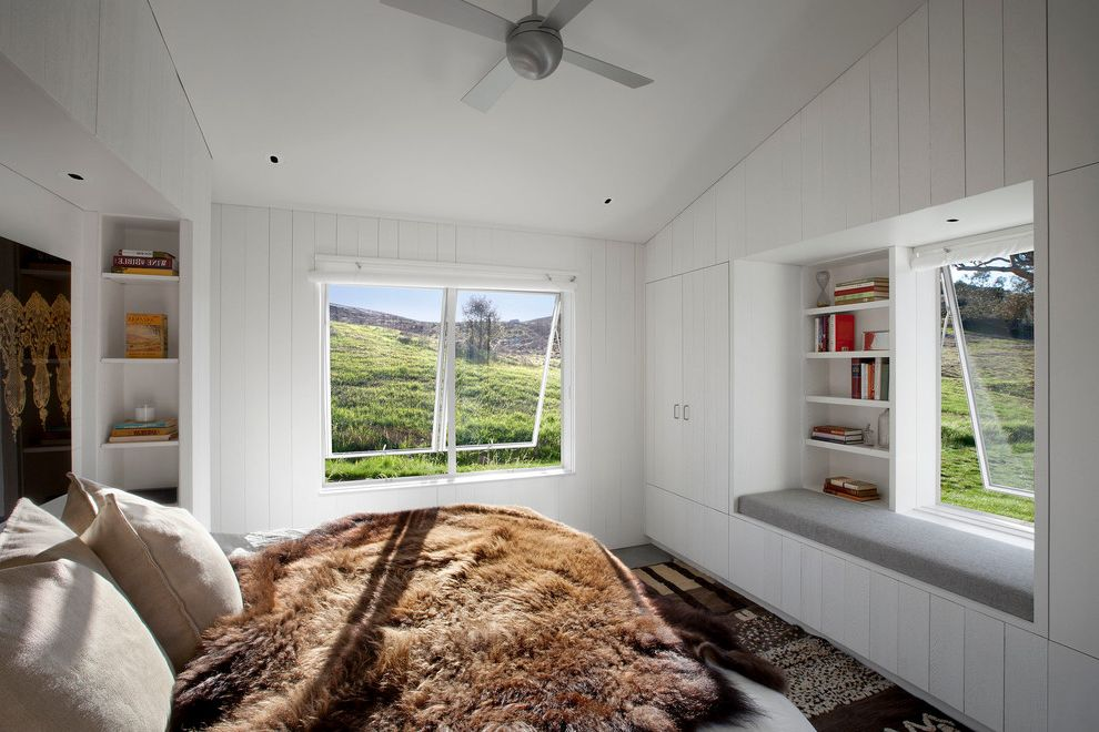 Unruh Furniture with Farmhouse Bedroom Also Awning Windows Built in Cabinets Built in Bench Furry Throw Modern Ceiling Fan Vertical Shiplap Walls