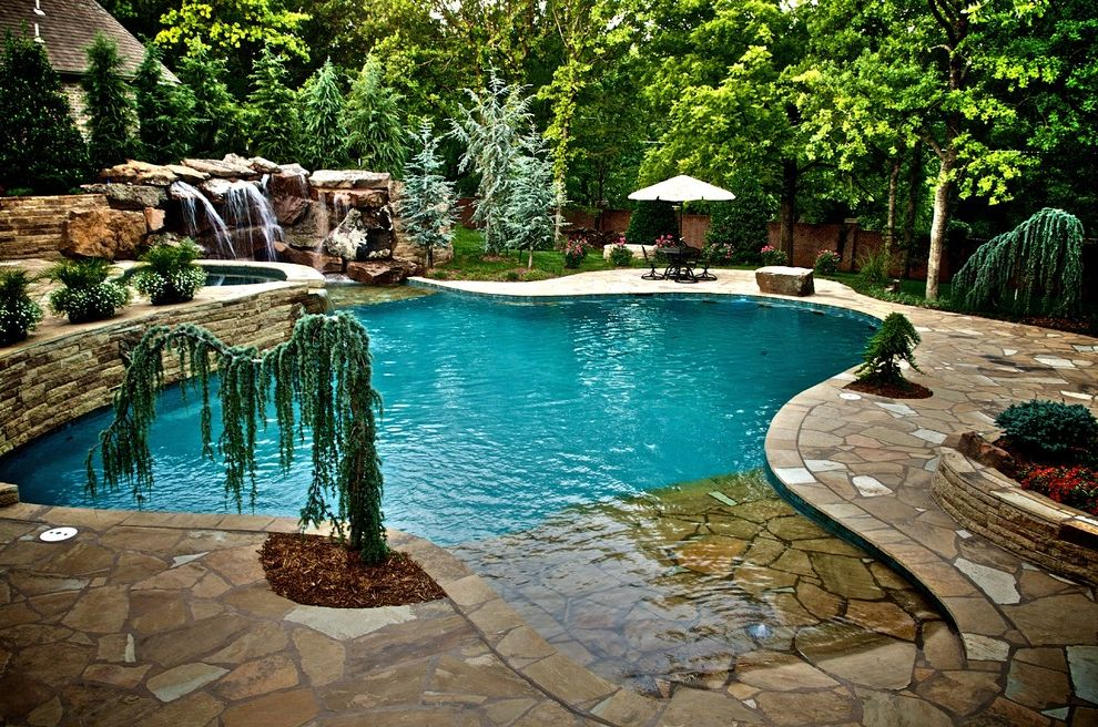 Waterfalls in Oklahoma   Mediterranean Pool  and Beach Entry Cedar Custom Pools Dream Pool Flagstone Glass Tile Landscaping Luxury Pools Natural Setting Pool Pavers Planters Spa Stone Wall Waterfalls