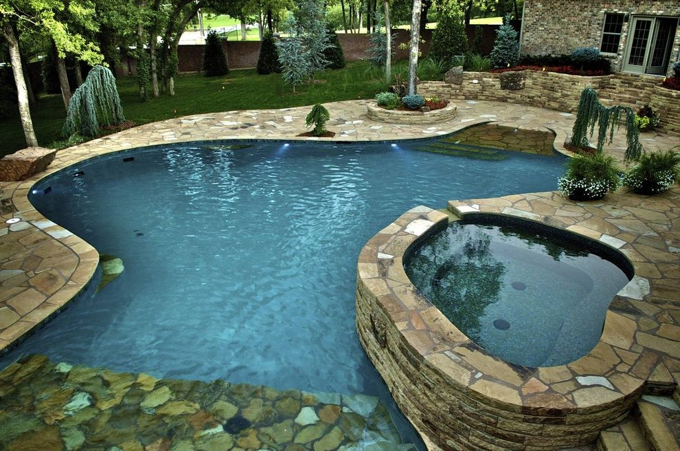 Waterfalls in Oklahoma   Mediterranean Pool  and Beach Entry Custom Pools Dream Pool Flagstone Glass Tile Landscaping Luxury Pools Natural Setting Pool Spa Waterfalls