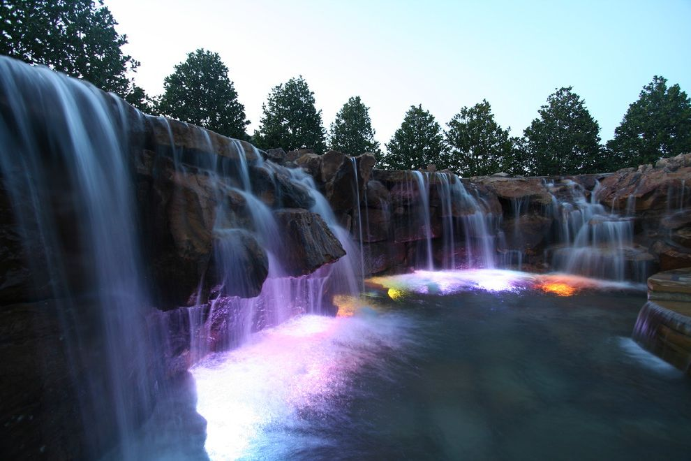 Waterfalls in Oklahoma   Rustic Pool  and Color Kinetics Lighting Flagstone Natural Looking Swimming Pools Pool Designs Waterfalls