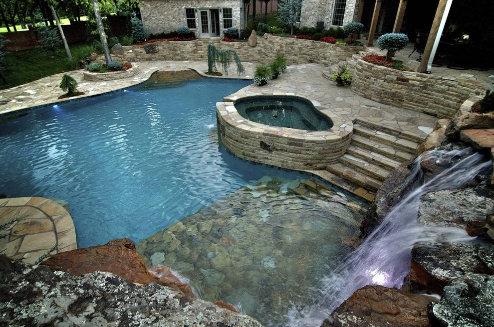 Waterfalls in Oklahoma with Mediterranean Pool  and Beach Entry Custom Pools Dream Pool Flagstone Glass Tile Landscaping Luxury Pools Natural Setting Pool Spa Stone Retaining Walls Waterfalls