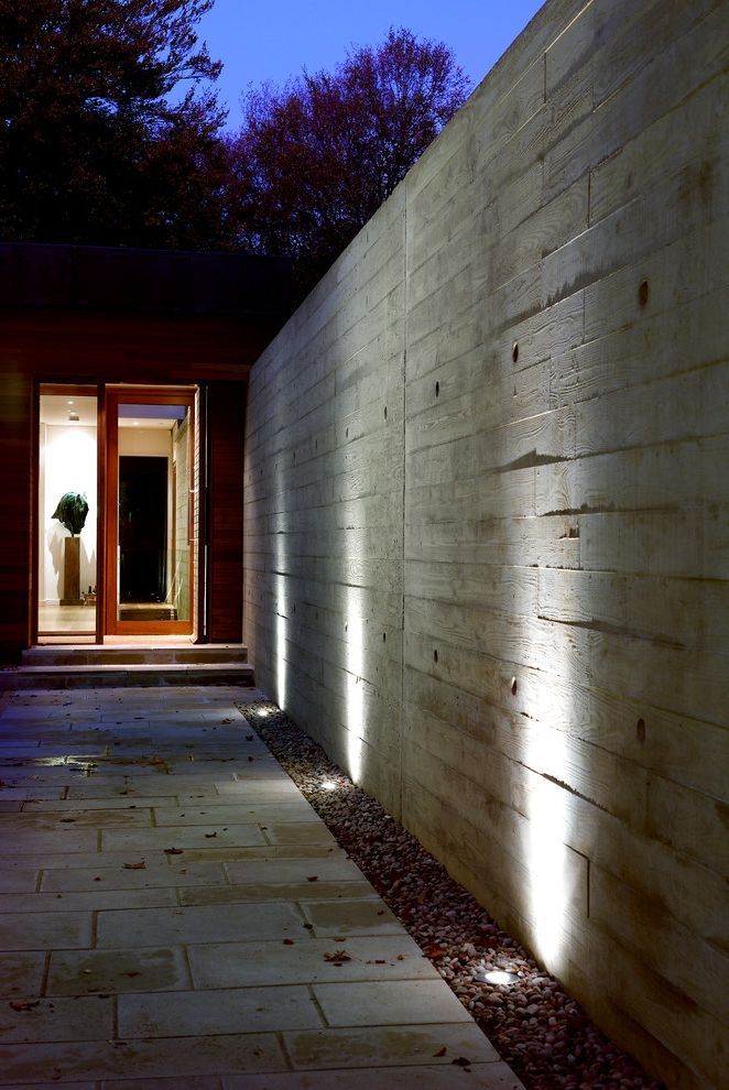 What is a Berm   Modern Entry Also Board Formed Concrete External Lights Garden Lighting Ipe Cladding Natural Swimming Pond Outdoor Lighting Textured Concrete Wall