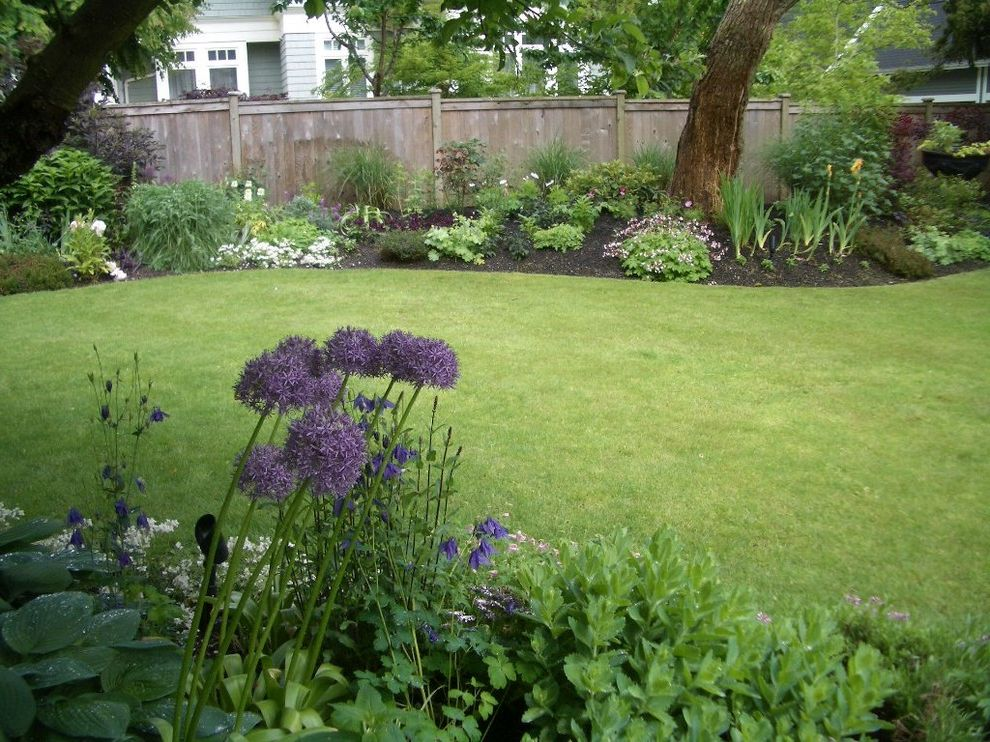 What is a Berm   Traditional Landscape  and Allium Annuals English Perennial Hardy Geranium Hosta Lawn Perennial Border Perennials Plants and Flowers Vancouver Vancouver Gardens