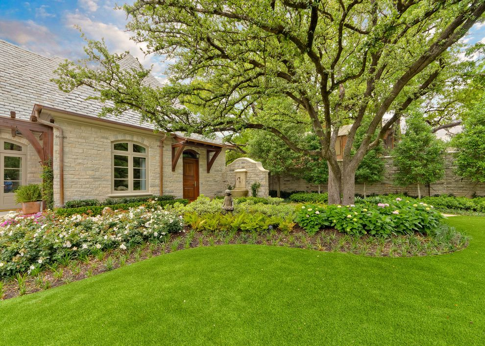 What is a Berm   Traditional Landscape  and Aquatic Backyard Flowers Fountain Garden Garden Sculpture Grass Lawn Plants Shingle Roof Stone Exterior Stone Fence Trees Water Feature Windows Wood Door