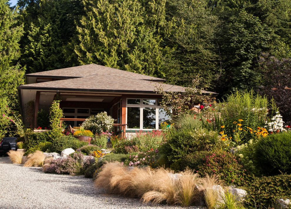 What is a Berm   Transitional Exterior Also Curb Appeal Ecofriendly Entrance Entry Flowers Forest Front Yard Garden Grasses Gravel Driveway Green Landscape Mass Planting Naturalistic Roberts Creek Sustainable Trees