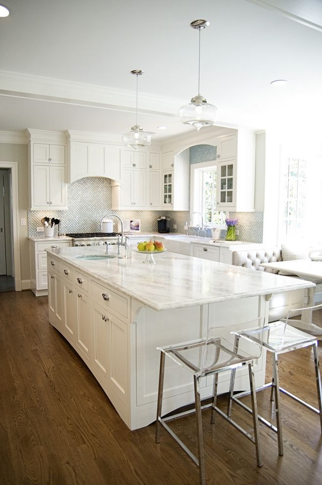 What is Quartzite   Traditional Kitchen  and Aqua Kitchen Breakfast Nook Lucite Stools Traditional Kitchen White Inset Cabinets White Kitchen White Princess Quartzite Wood Floor