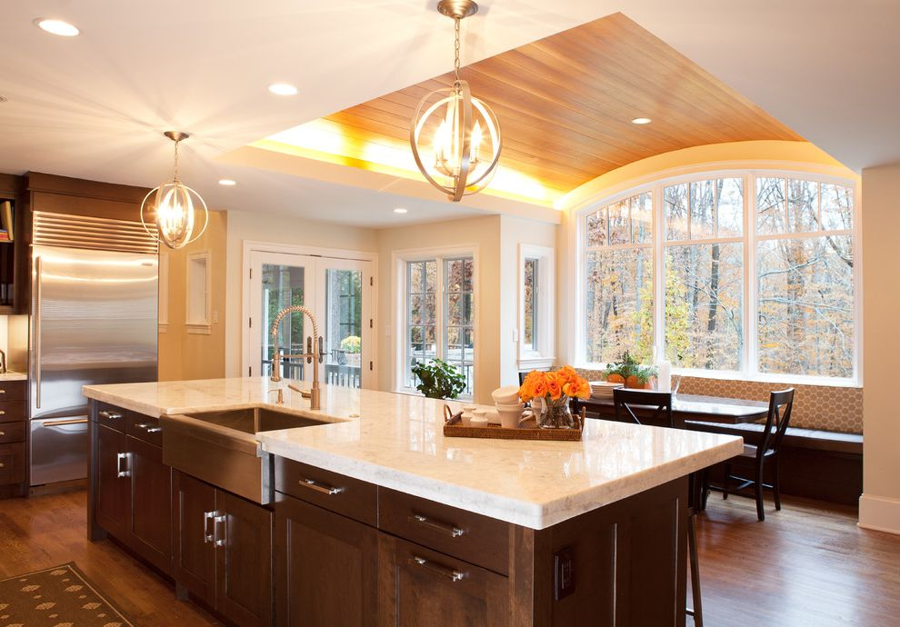 What is Quartzite   Transitional Kitchen Also Apron Sink Breakfast Nook Brookhaven Cabinetry Ceiling Lighting Cove Lighting Curved Ceiling Eat in Kitchen Farmhouse Sink Recessed Lighting Stainless Steel Appliances Wood Ceiling