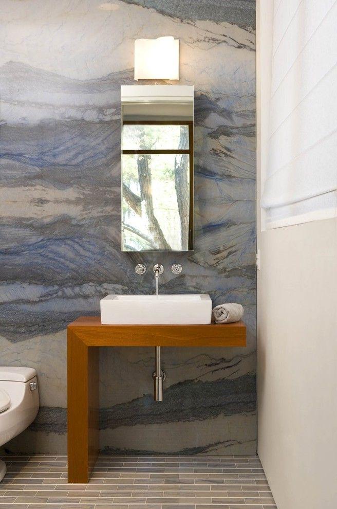 What is Quartzite with Contemporary Bathroom  and Guest Bath Half Bath Minimalist Modern Fixtures Modern Vanity Quartzite Rock Slab Slab Wall Square Sink Tile Floor Window Shade Wood Counter Wood Vanity