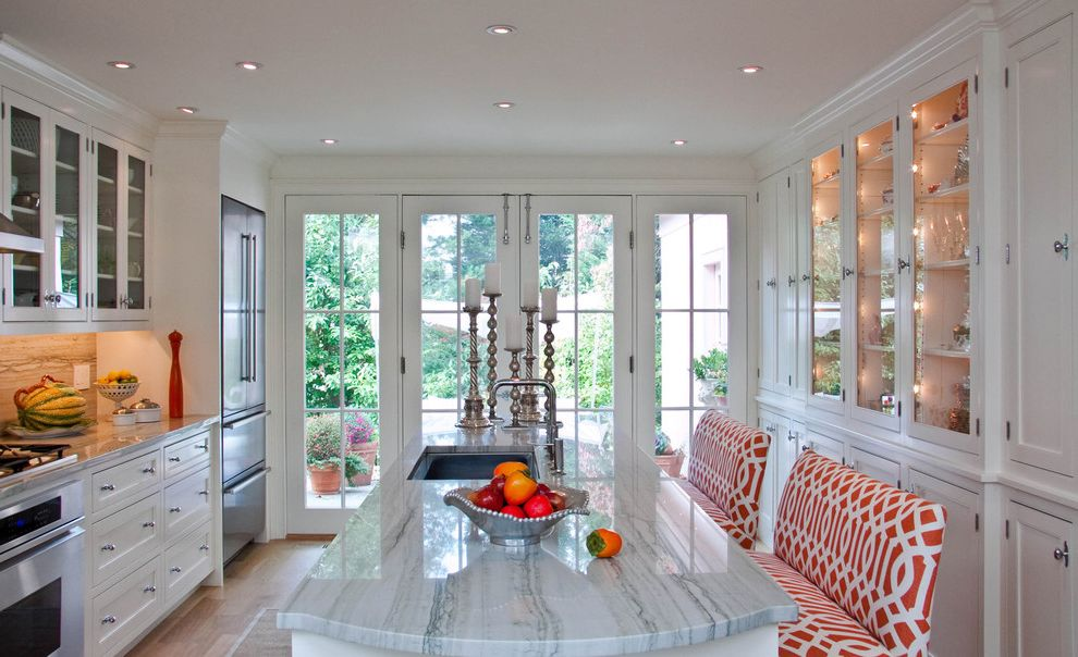 What is Quartzite with Contemporary Kitchen Also Bench Seats Frame and Panel Woodwork French Doors Glass Front Cabinets Kitchen Island Stainless Steel Appliances White Cabinets Wood Floor