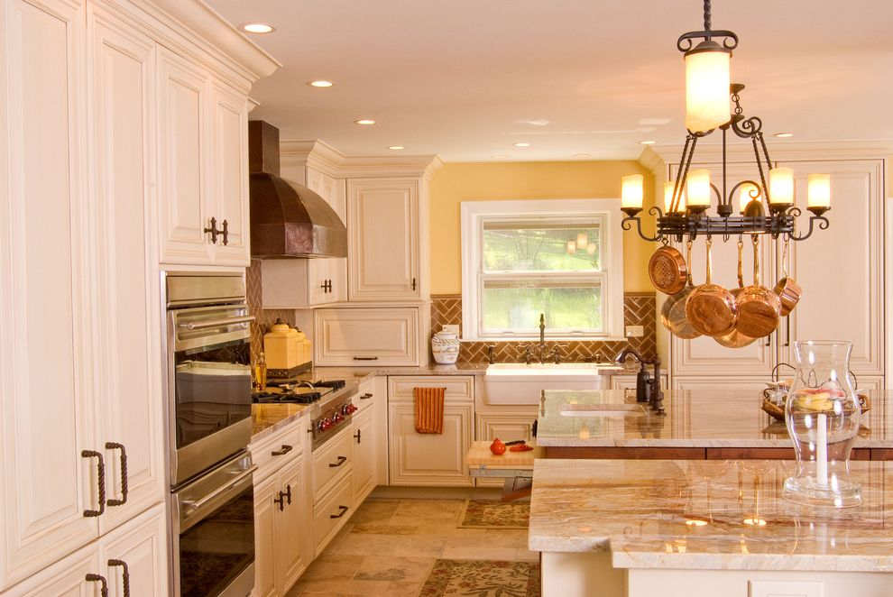 What is Quartzite with Traditional Kitchen Also Ceiling Lighting Chandelier Copper Cookware Double Islands Double Ovens Herringbone Pattern Kitchen Island Range Hood Recessed Lighting Tile Kitchen Backsplash