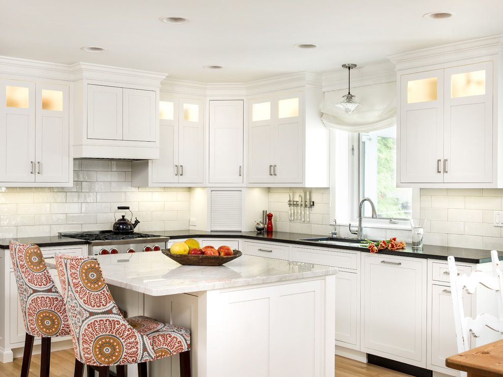 What is Quartzite with Transitional Kitchen  and Glass Cabinets Pendant Quartzite Upholstered Stools White Kitchen Window Window Shade