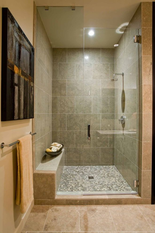 What is the Primary Difference Between Porcelain and Ceramic Tile   Contemporary Bathroom Also Glass Shower Door Master Shower Mosaic Tile Natural Stone Neutral Colors Rain Shower Head Shower Bench Street of Dreams Tile Floor Wall Art Wall Decor