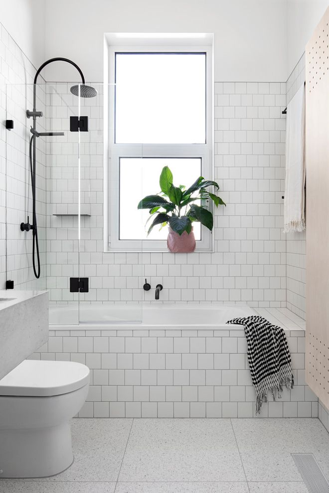 What is the Primary Difference Between Porcelain and Ceramic Tile   Scandinavian Bathroom  and Black Fittings Black Fixtures Blonde Palette Bronze Frosted Glass Window Grey Floor Tile Indoor Plant Rainfall Showerhead Scandinavian Interior Subway Tile