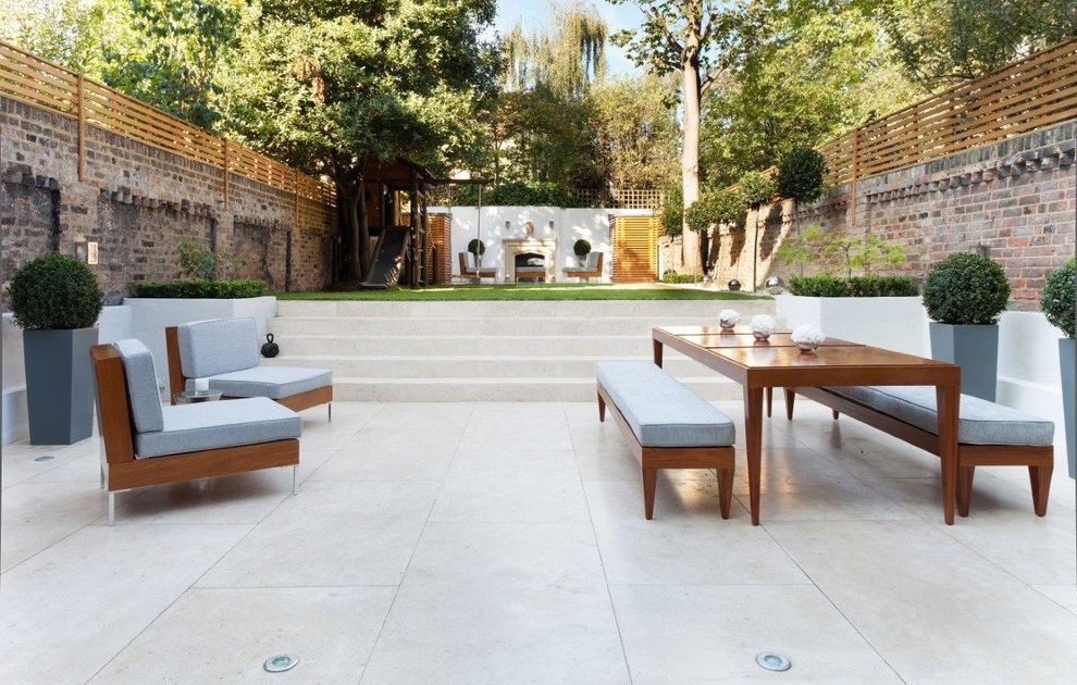 What is the Primary Difference Between Porcelain and Ceramic Tile with Transitional Patio Also Bench Blue Cushions Brick Walls Chairs Fences Garden Gardens Marble Outdoor Chairs Outdoor Dining Outdoor Fireplace Outdoors Patio Rear Garden