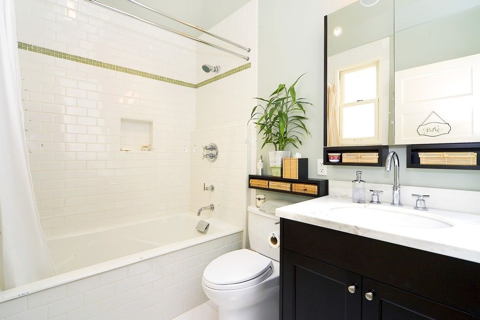 10 Inch Rough in Toilet with Traditional Bathroom  and Bathroom Storage Black Vanity Green Accent Tiles Inset Shelf Light Light Blue Walls Marble Countertop Shower Curtain Small Bathroom Subway Tile Tub and Shower Combination