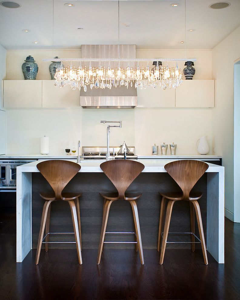 34 Inch Bar Stools   Contemporary Kitchen  and Ceiling Lighting Dark Floor Kitchen Island Linear Chandelier Neutral Colors Pot Filler Range Hood Recessed Lighting Stainless Steel Appliances Two Tone Cabinets Waterfall Counters