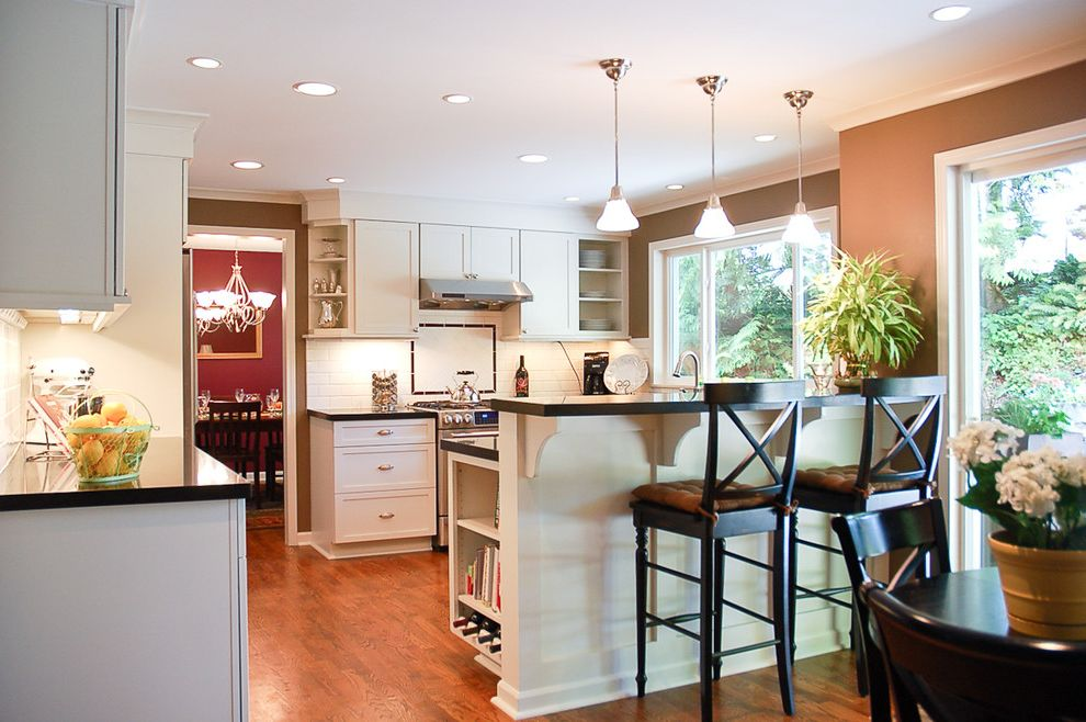 34 Inch Bar Stools   Traditional Kitchen Also Breakfast Bar Ceiling Lighting Eat in Kitchen Kitchen Shelves Pendant Lighting Range Hood Recessed Lighting Under Cabinet Lighting White Cabinets White Wood Wood Cabinets Wood Trim