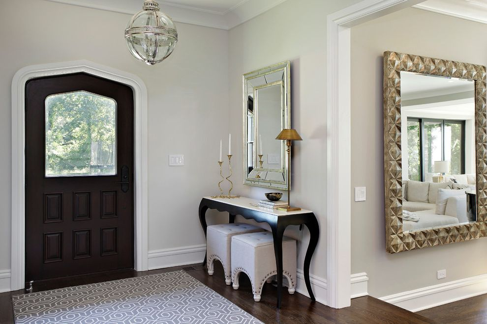 72 Inch Console Table   Transitional Entry  and Baseboards Console Table Entry Table Globe Pendant Upholstered Footstool White Trim Wood Floors Wood Front Door