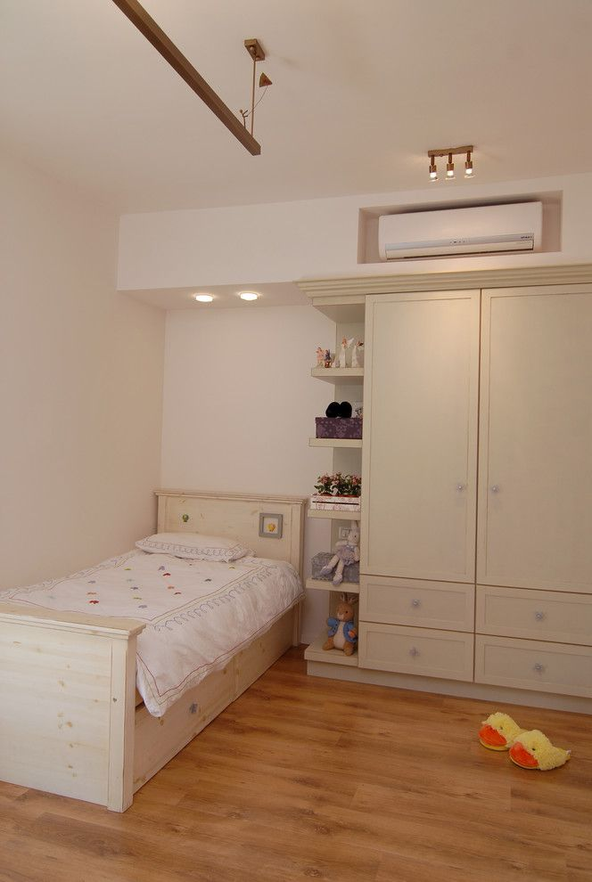 Ac Wall Units   Contemporary Kids  and Armoire Bedroom Ceiling Lighting Closet Neutral Colors Rubber Ducky Slippers Storage Toy Storage Twin Bed White Bedding Wood Flooring Wooden Bed