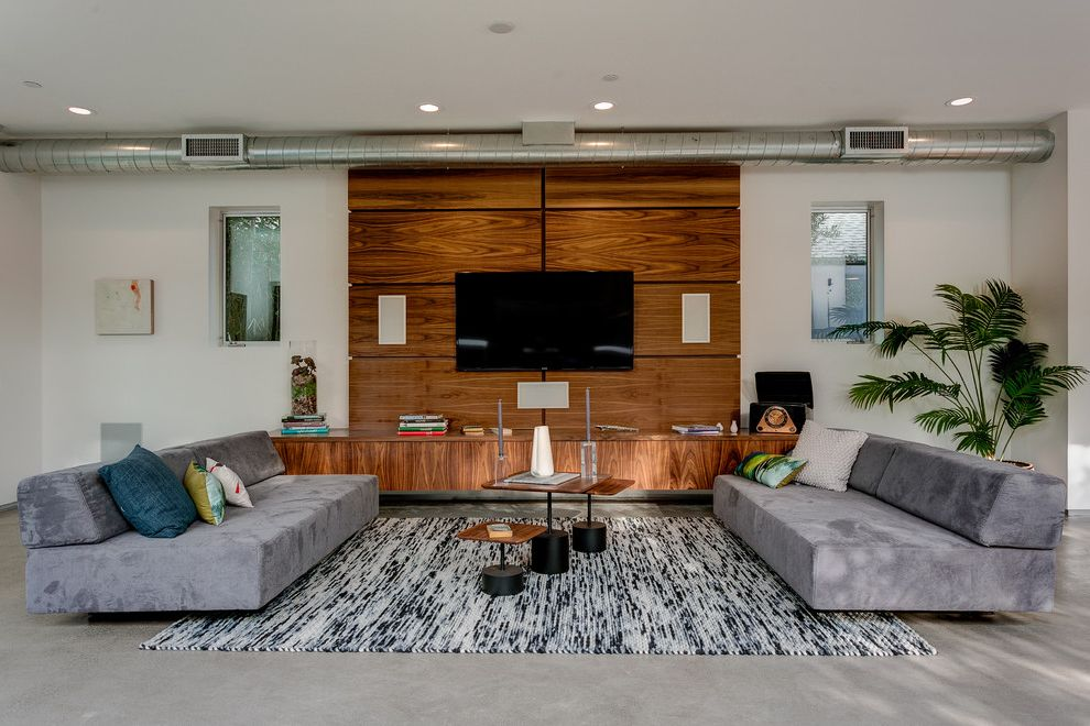 Ac Wall Units   Contemporary Living Room  and Black and White Area Rug Built in Wall Unit Media Contemporary Design Exposed Hvac Gray Sofas Nesting Wooden Coffee Tables Recessed Lighting Recessed Windows Stacked Books Symmetry Throw Pillows