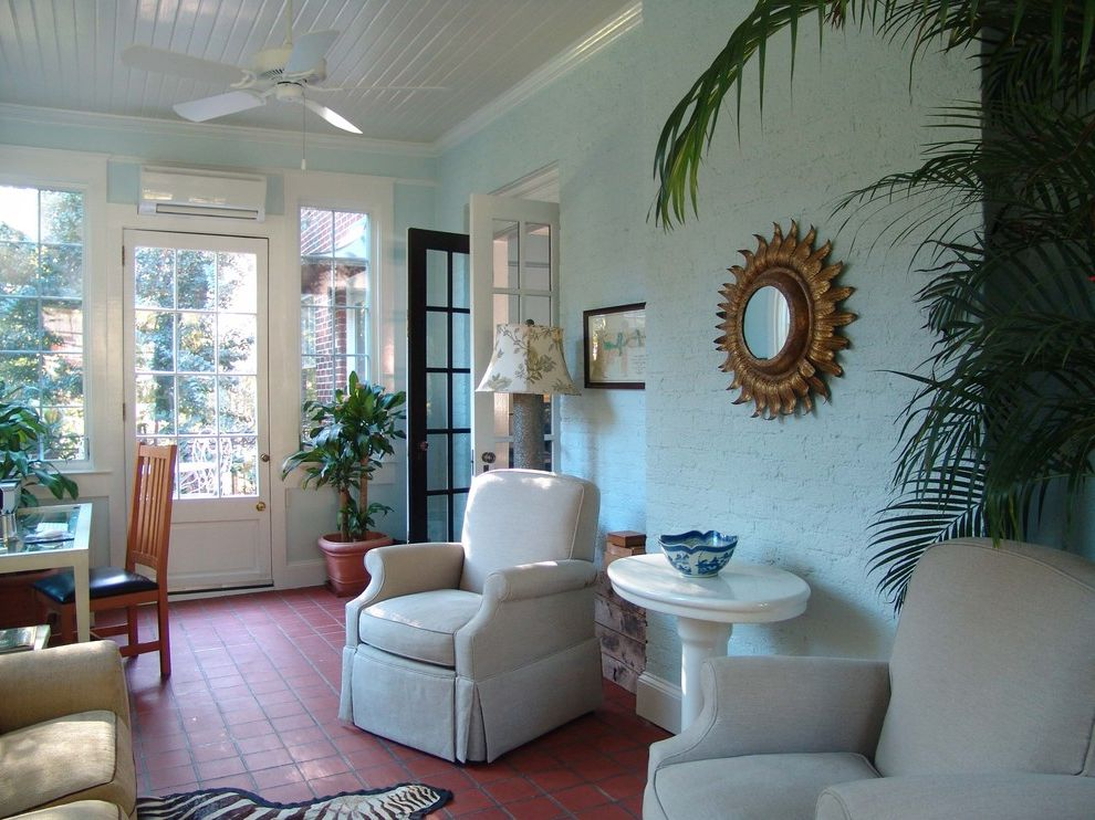 Ac Wall Units with Traditional Sunroom Also Exposed Brick French Door Gold Mirror Houseplant Painted Brick Slat Ceiling Sunburst Mirror Terracotta Floor Tile Floor Upholstered Armchair White Side Table Zebra Rug