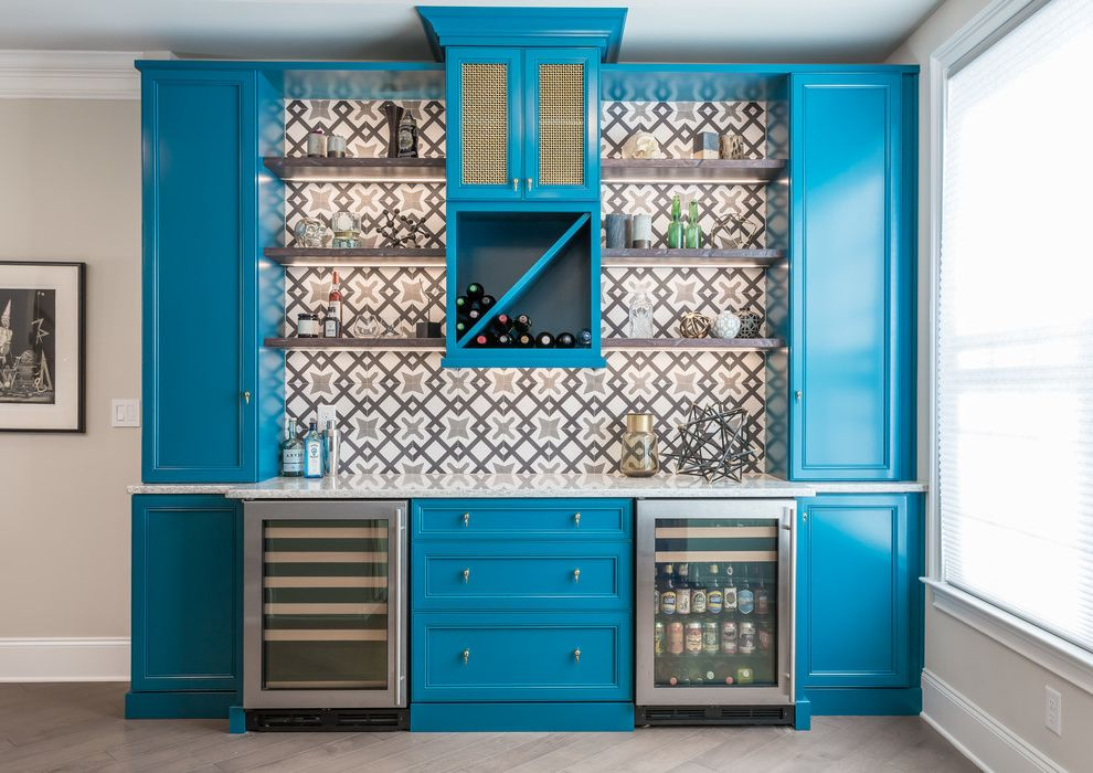 Academy of Art University Reviews   Traditional Home Bar  and Bar Cabinet Beverage Fridge Blue Cabinets Cement Tile Floating Shelves Patterned Backsplash Under Cabinet Lighting Wine Fridge Wine Storage