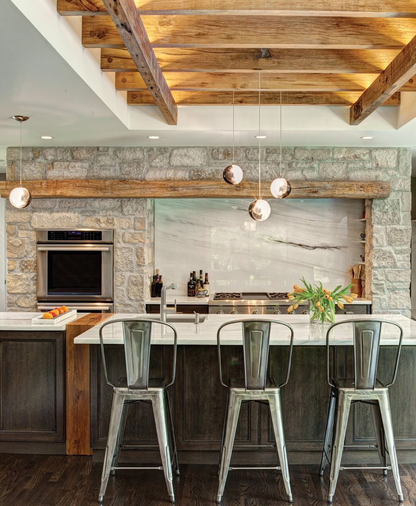 Aj Madison Reviews with Rustic Kitchen  and Contemporary Exposed Beams Floral Arrangement Flowers Globe Pendant Light Hardwood Flooring High Ceilings Island Seating Kitchen Countertops Marble Natural Elements Pendant Lighting Stone Tall Ceilings