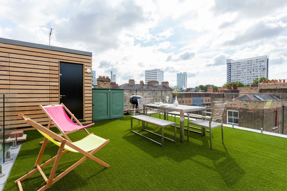 Artificial Grass Liquidators with Contemporary Deck  and City View Glass Railing Outdoor Dining