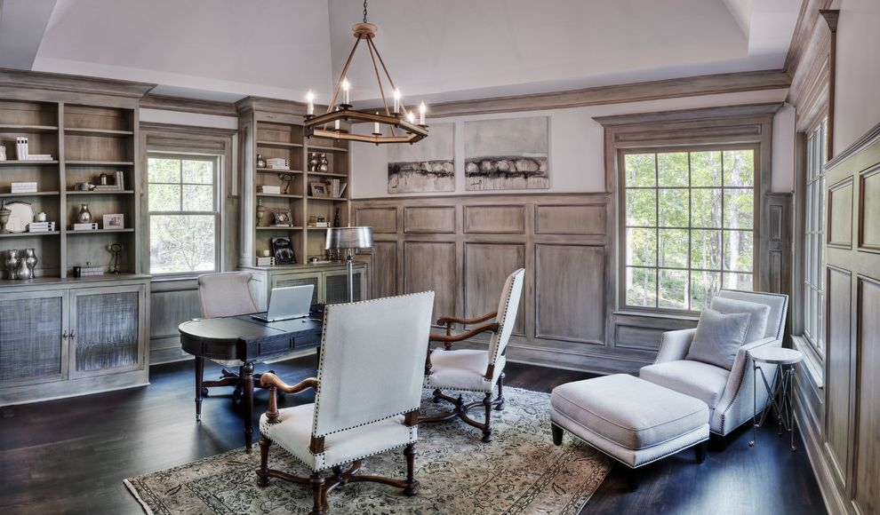 Ashley Furniture Greenville Sc   Traditional Home Office  and Area Rug Built in Shelves Built in Storage Chandelier Dark Floor Divided Lights Nail Head Trim Sloped Ceiling Vaulted Ceiling Wainscoting Wood Flooring Wood Paneling
