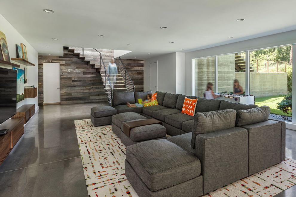 Ashley Furniture Greenville Sc with Contemporary Family Room  and Area Rugs Cable Rail Staircase Comfortable Floating Casework Foosball Table Lounge Ottoman Polished Concrete Sectional Windows Wood Accent Wall