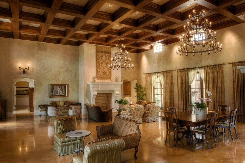 Ashley Furniture Greenville Sc with Mediterranean Living Room  and Chandelier Coffered Ceiling Earth Tone Colors Great Room Limestone Fireplace Surround Multiple Seating Areas Plaster Wall Tiered Chandelier Wall Treatments