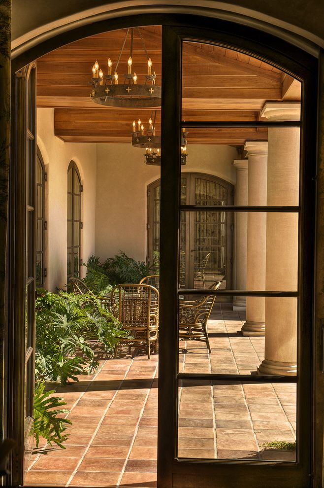 Ashley Furniture Greenville Sc with Mediterranean Porch  and Arch Doorway Chandelier Columns French Doors Loggia Outdoor Dining Patio Doors Patio Furniture Terracotta Tile Wood Ceiling