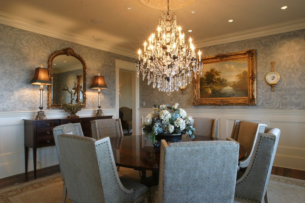 Ashley Furniture Greenville Sc with Traditional Dining Room Also Area Rug Buffet Ceiling Medaliion Chandelier Crown Molding Formal Gilt Mirror Nail Head Detail Table Lamps Upholstered Chairs Wainscot Wall Paper Wood Floor