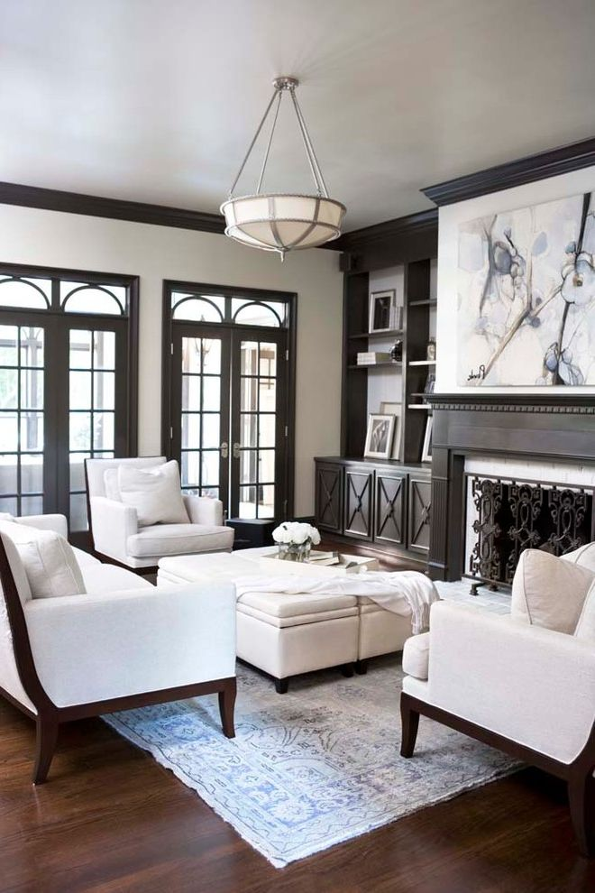 Ashley Furniture Greenville Sc with Traditional Living Room  and Built in Cabinets Built in Shelves Ceiling Light Contemporary Painting Dark Wood Fireplace Mantel Glass Doors Ivory Armchair Ivory Sofa Transom Upholstered Ottoman