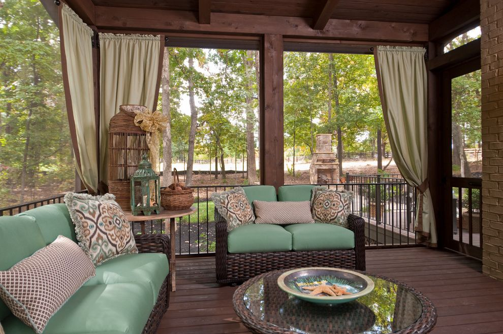 Ashley Furniture Greenville Sc with Traditional Porch Also Brick Curtain Panels Dark Stained Wood Green Seat Cushions Lantern Loveseat Outdoor Fireplace Pillows Railing Sofa Sreeened Porch Wicker Wood Deck Woven Outdoor Furniture