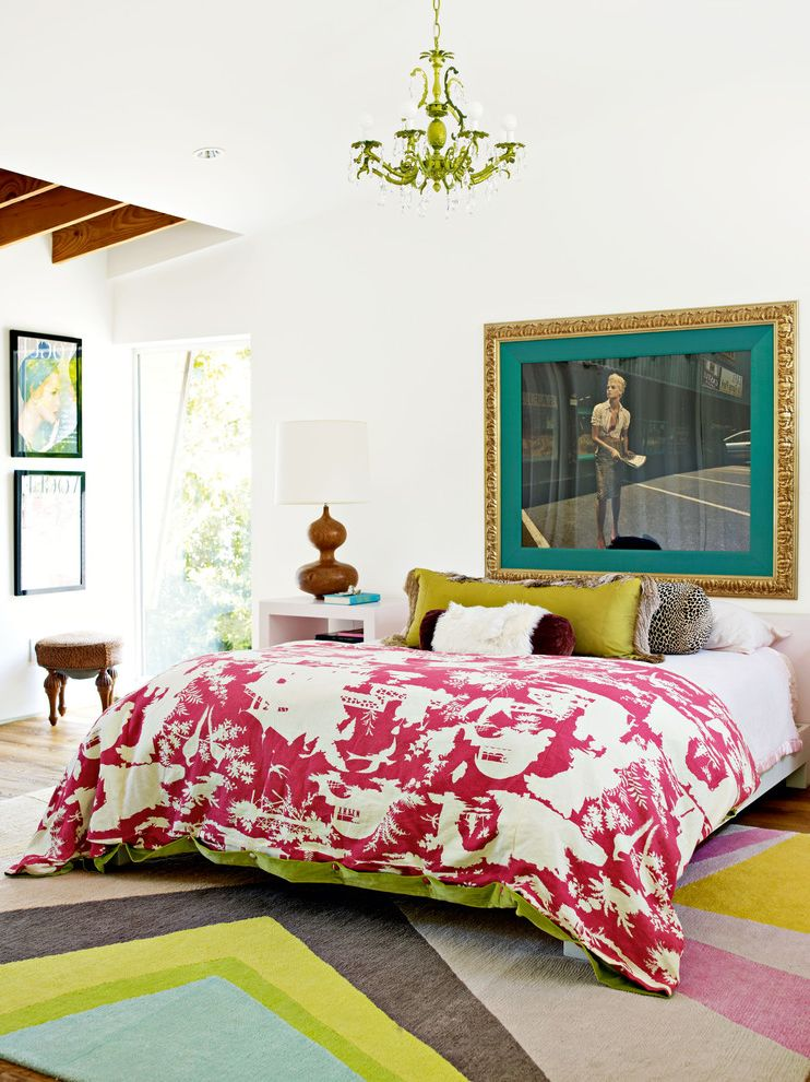 Bright Floral Rug   Eclectic Bedroom Also Artwork Bright Pattern Rug Decorative Pillows Exposed Wood Beams Gold Frame Graphic Bedding Green Chandelier Stool White Walls Wood Flooring Wood Table Lamp