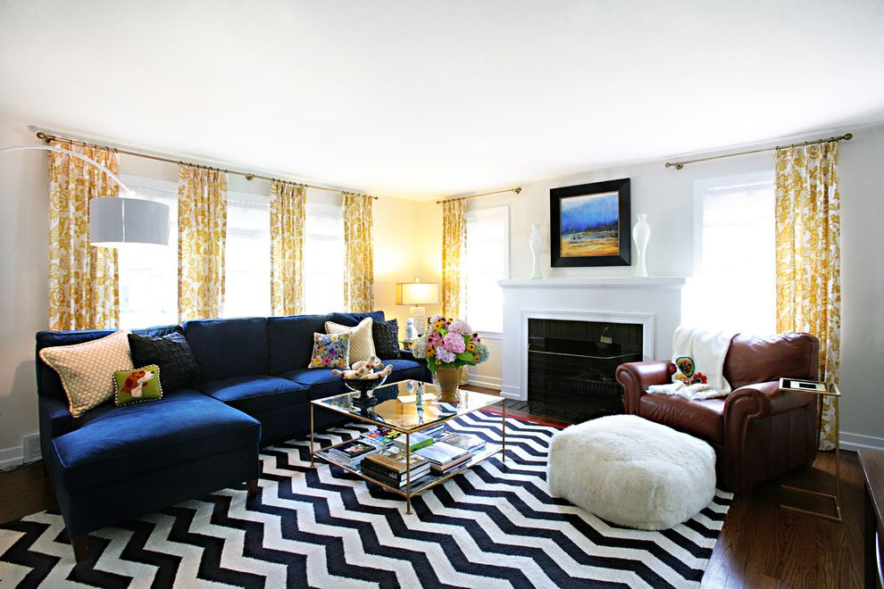 Bright Floral Rug with Transitional Living Room  and Black and White Chevron Curtains Electric Blue Fireplace Floral Glass Coffee Table Gold Jewel Tone Mantle Print Royal Blue Sectional Sofa Square Coffee Table Window Treatments Yellow Zig Zag