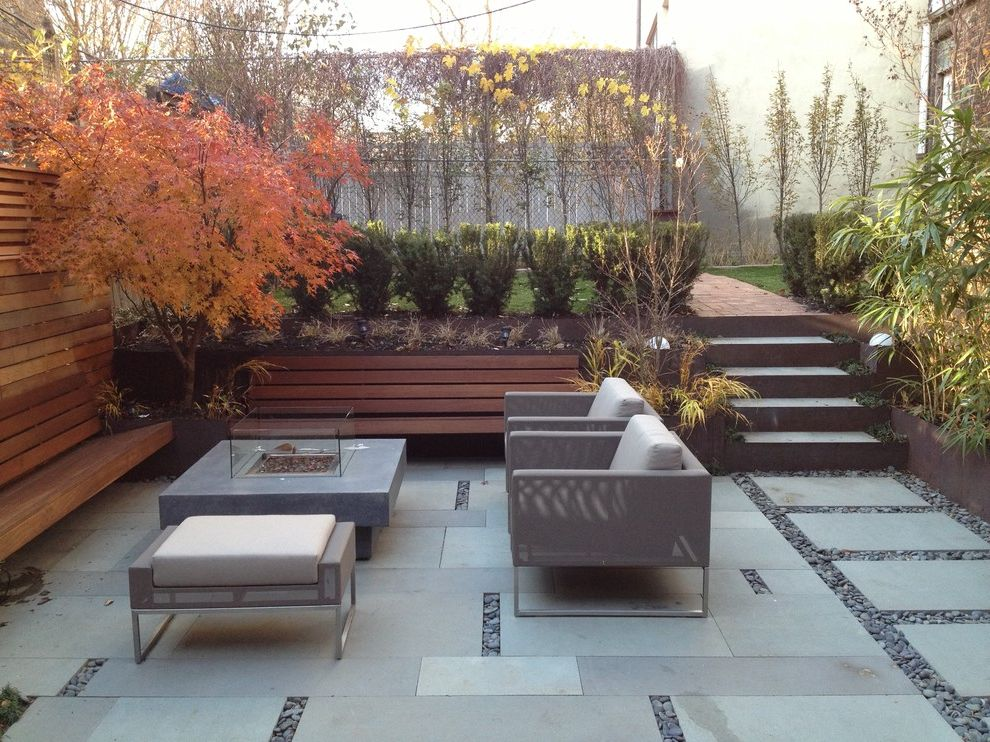 Building a Patio with Pavers   Modern Landscape  and Bench Seating Mass Planting Outdoor Fireplace Outdoor Furniture Patio Patio Furniture Stepping Stones River Rock