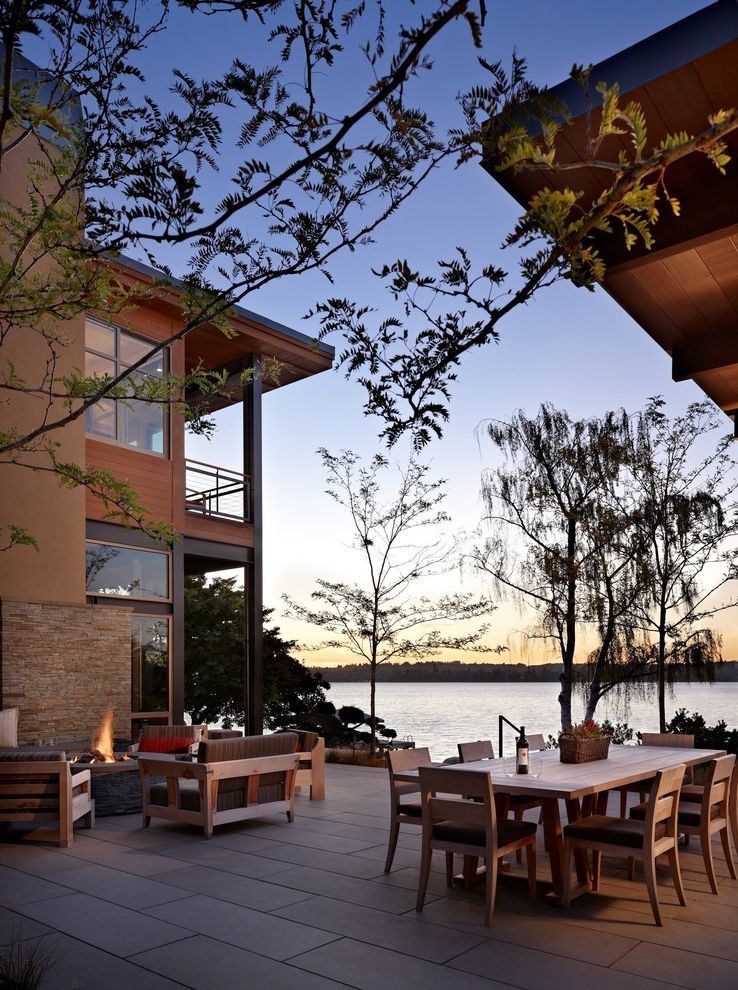 Building a Patio with Pavers   Modern Patio  and Balcony Blackened Steel Cedar Siding Concrete Pavers Deck Chairs Fire Pit Flat Roof Outdoor Room Steel Beams Stucco Waterfront