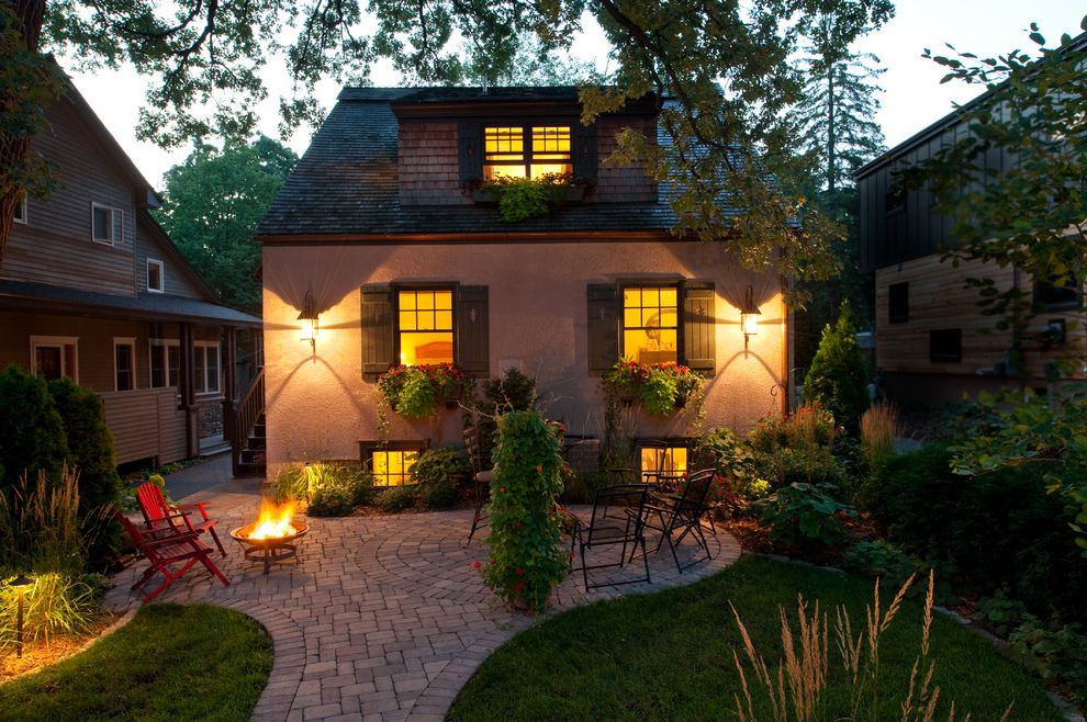 Building a Patio with Pavers   Traditional Patio Also Dormer Windows Grass Lanterns Lawn Outdoor Firebowl Patio Pavers Shake Roof Shingle Siding Stucco Wall Turf Window Boxes Window Shutters