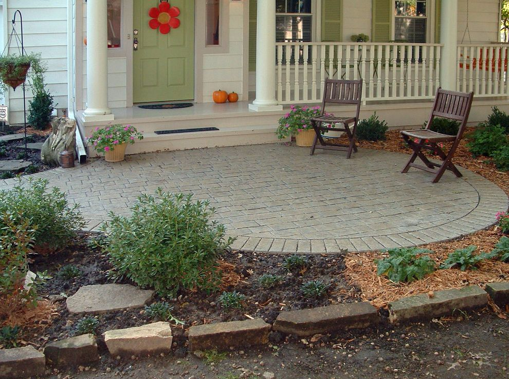 Building a Patio with Pavers   Traditional Porch  and Bark Mulch Columns Covered Entry Gray Painted Trim Green Front Door Green Shutters Landscaping Lap Siding Outdoor Seating Pavers Plant Pots Porch Porch Swing Wood Railing