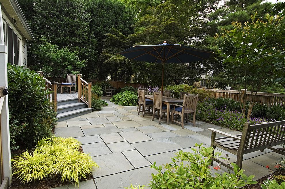 Building a Patio with Pavers with Rustic Patio  and Border Plantings Deck Garden Bench Outdoor Dining Patio Furniture Patio Umbrella Pavers Planters Rustic Wood Fencing