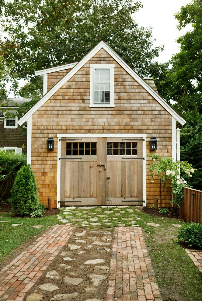 Burns Pest Control   Beach Style Garage Also Barn Doors Brick Pavers Outdoor Sconces Shingle White Trim Window