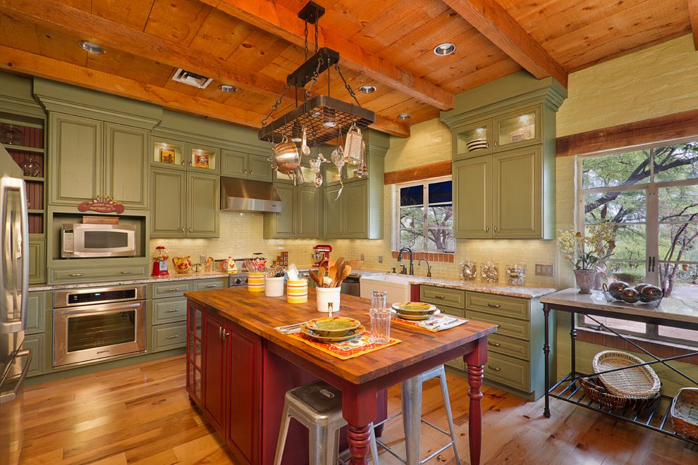 Cabinets to Go with Traditional Kitchen Also Butcher Block Cabinets to Ceiling Green Cabinets Kitchen Island Metal Bar Stools Pot Rack Red Red Island Seating Wood Beams Wood Ceiling